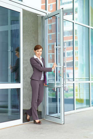 Businesswoman opens door. photo