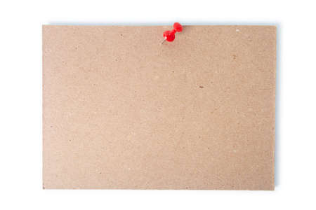 Single piece of cardboard pinned with a thumb tack with clipping path. Stock Photo