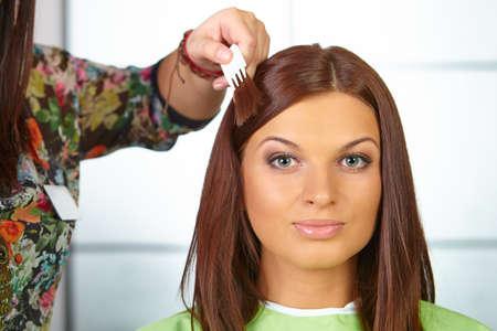 hair dye: Hair salon. Woman choses color of dye.