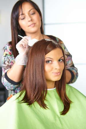 Hair salon. Application of cosmetics. photo