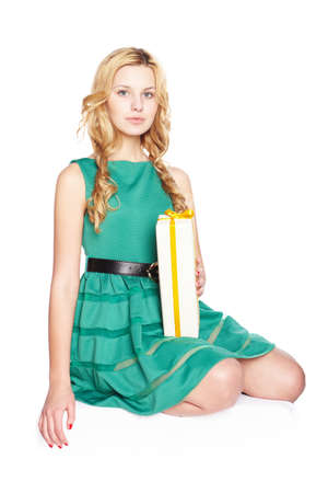 only one young woman: Beautiful blonde young woman with gift box.