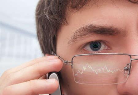 financier: Financier in glasses looking at monitor. Stock Photo