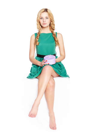 Beautiful blonde young woman with gift box. photo
