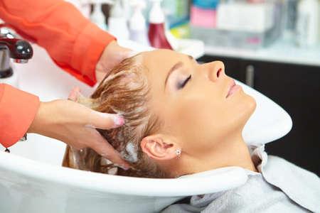 washing hair: Hair salon. Washing with shampoo. Stock Photo