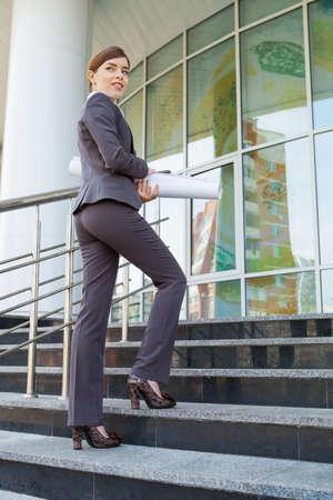 upstairs: Businesswoman goes upstairs. Stock Photo