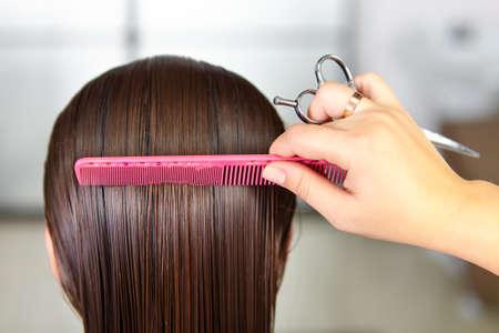 combing hair: Hair salon. Woman haircut. Cutting.