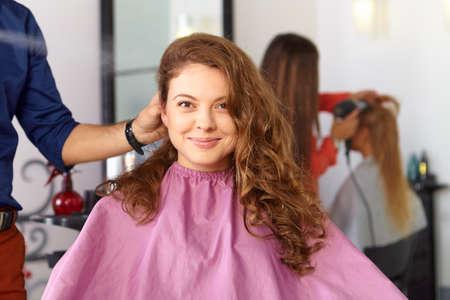 Hair salon. Woman haircut. Combing. photo