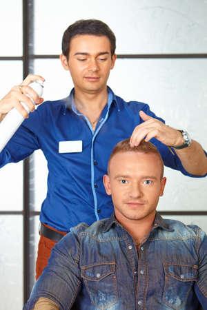 hairspray: Hair salon. Man haircut. Spraying.