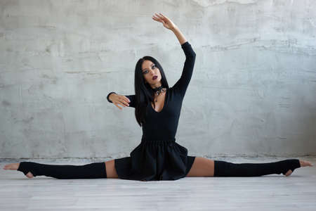 Gothic gymnast does the splits