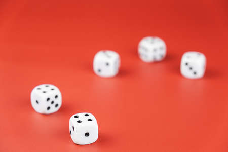 five dice lie on a red background. gambling and luck