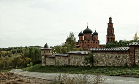 street creed: Orthodox monastery surrounded with a stone fence in the nature Stock Photo