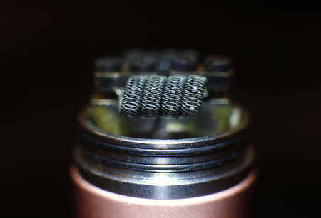 Staple staggered fused clapton coil in vaping rebuildable dripping atomizer