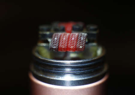 Burning staple staggered fused clapton coil in rebuildable dripping atomizer