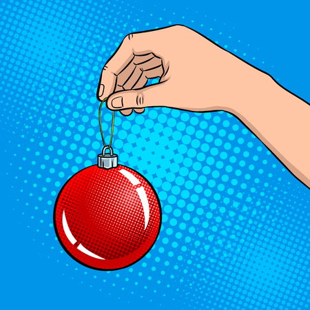 Hand with Christmas tree toy pop art retro illustration.