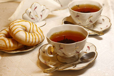 Cup tea with sweets
