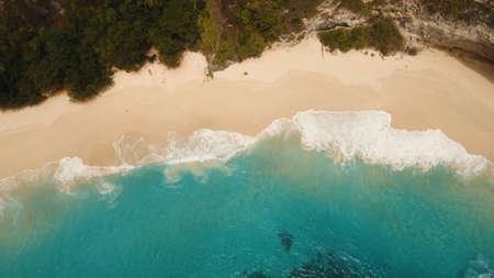 Tropical beach among rocky cliffs. Karang Dawa, Manta Bay or Kelingking Beach on Nusa Penida Island, Bali, Indonesia. Travel concept.