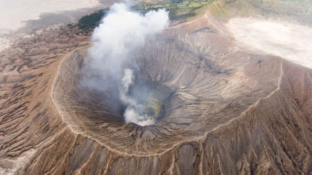 Crater with active volcano smoke in East Jawa, Indonesia. Aerial view of volcano crater Mount Gunung Bromo is an active volcano,Tengger Semeru National Park. Stock Photo