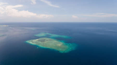 Aerial view coral reef, atoll with turquoise water in the sea.