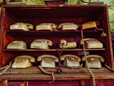 Antique street shop with old telephones in Bali. Stock Photo