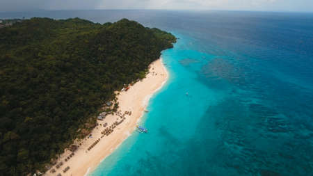 Aerial view of beautiful tropical island with with azure water, Boracay. Tropical lagoon with turquoise water. Beautiful tropical beach on the island. Seascape: Beautiful view of the rock in the sea from the air. Philippines Travel concept. Stock Photo
