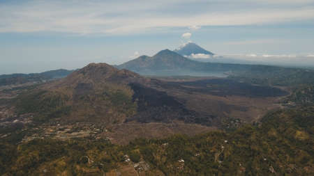 Aerial view crater lake Batur, volcanoes Batur, Agung. Bali, Indonesia. Mountain landscape with volcanoes, lake on the background of the sky and clouds. Travel concept.