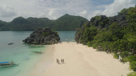Aerial view with sand beach and turquoise water, Matukad island, Caramoan, Philippines. Landscape with sea, tropical beach. Stock Photo