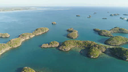 Aerial view of Small islands with beaches and lagoons in Hundred Islands National Park, Pangasinan, Philippines. Famous tourist attraction, Alaminos.