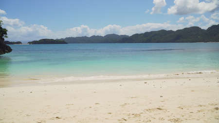 Sand beach and turquoise water, Matukad island, Caramoan, Philippines. Landscape with sea, tropical beach