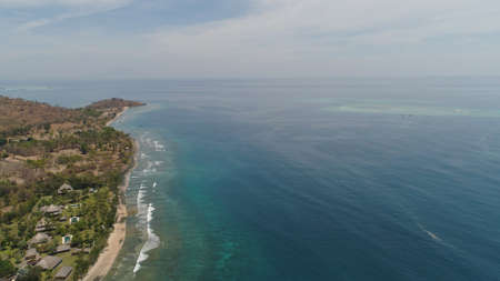 sea coast with tropical beach. aerial view tropical landscape, sea, boats on the surface of the water. Bali,Indonesia, travel concept.