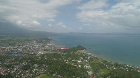 Aerial view city Legazpi in background Mayon volcano. Tropical landscape city near volcano on seashore, Philippines, Luzon. Stock Photo
