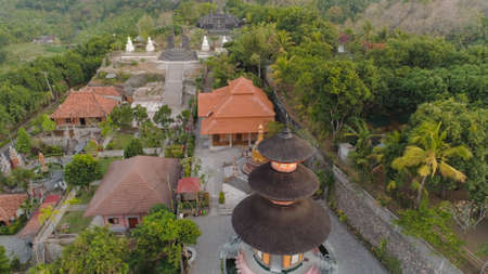 buddhist temple Brahma Vihara Arama with statues gods. aerial view balinese temple, old hindu architecture, Bali architecture, ancient design. Travel concept. indonesia 版權商用圖片