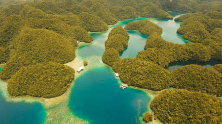 Aerial view: Bucas Grande Island, Sohoton Cove. Philippines. Tropical sea bay and lagoon, beach. Tropical landscape hill, clouds and mountains rocks with rainforest. Azure water of lagoon. Shore Landscape Bay. Aerial video.Seascape. Travel concept.