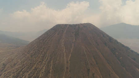 mountain landscape with volcano and mountains Tengger Semeru National park, Java, Indonesia. Aerial view volcano crater Stock Photo