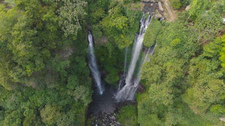 waterfall in green rainforest. Aerial view triple tropical waterfall Sekumpul in mountain jungle. Bali,Indonesia. Travel concept.