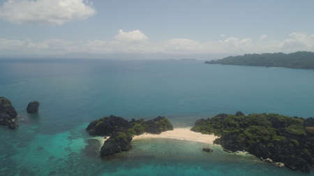 Aerial view islands with sand beach Lahus and turquoise water in lagoon among coral reefs, Caramoan Islands, Philippines. Landscape with sea, tropical beach.