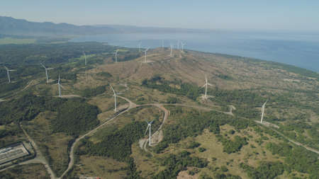 Aerial view of Windmills for electric power production on the seashore. Bangui Windmills in Ilocos Norte, Philippines. Ecological landscape: Windmills, sea in Pagudpud.