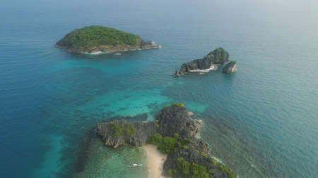 Aerial view islands with sand beach and turquoise water in lagoon among coral reefs, Caramoan Islands, Philippines. Landscape with sea, tropical beach.