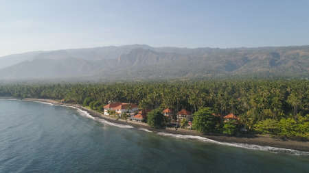 aerial seascape luxury hotel on beach background mountainss in tropical resort. Bali,Indonesia, travel concept.
