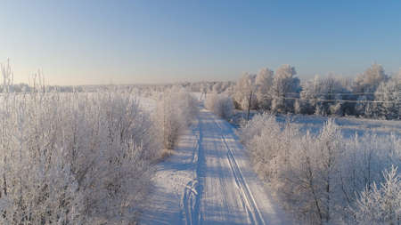 aerial view winter landscape countryside road through winter field with forest. winter forest on sunny day. winter in countryside Stock fotó
