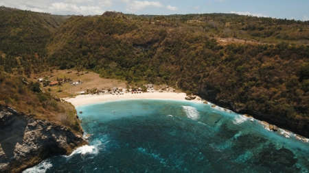 Aerial view beautiful white sand Atuh beach for relax. Clear blue ocean waves rolling to the beach. Nusa Penida, Bali, Indonesia. Travel concept. Stock fotó