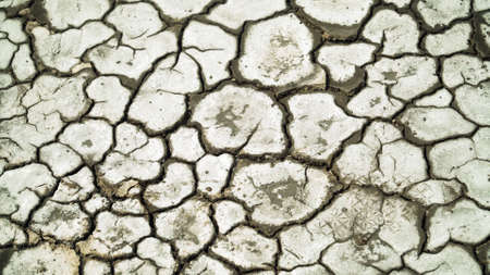 Dry cracked soil, Arid climate. Volcanic landscape around volcano. mountainous relief after volcanic eruption Standard-Bild - 115257654
