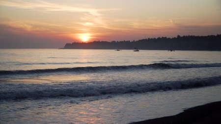 coastline with surf during sunset. sea sunset landscape on beach. Travel concept. Standard-Bild - 115257733
