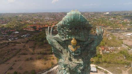 Aerial view statue hindu god garuda wisnu kencana Statue, Bali. Statue at entrance Garuda Wisnu Kencana Cultural Park. Standard-Bild - 115258104