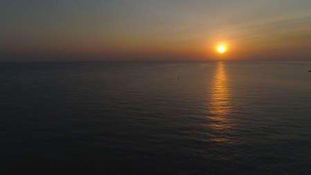aerial view sunrise over ocean. seascape colorful sunrise over sea at tropical resort Standard-Bild - 115258163