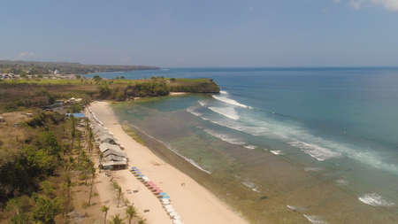 aerial view coastline with sandy tropical beach Balangan. seascape ocean surf and tropical beach large waves turquoise water crushing on shore, Bali,Indonesia. Travel concept. Standard-Bild - 115258330