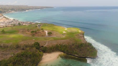 aerial view golf course on cape against ocean. golf course on tropical island on coastline. Standard-Bild - 115258332