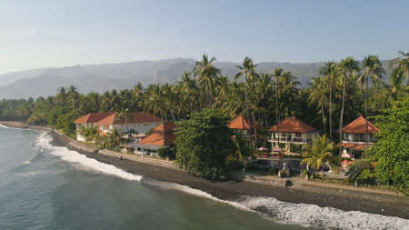 aerial seascape luxury hotel on beach background mountainss in tropical resort. Bali,Indonesia, travel concept. Standard-Bild - 115258403