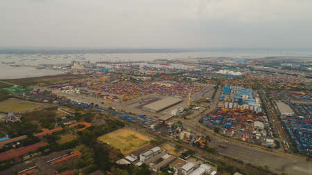 aerial view container terminal port surabaya. cargo industrial port with containers, crane. Tanjung Perak, indonesia. logistic import export and transport industry Standard-Bild - 115258422