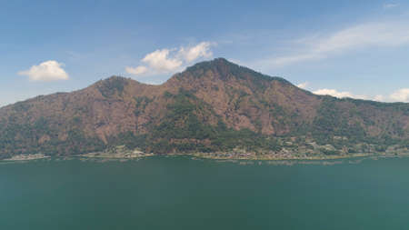 mountain landscape crater lake batur aerial view mountains with trees against blue sky Bali, Indonesia. Travel concept. Standard-Bild - 115258425