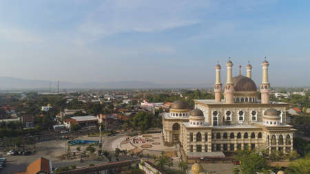 beautiful mosque with minarets on island Java Indonesia. aerial view mosque in an asian city Standard-Bild - 115258472
